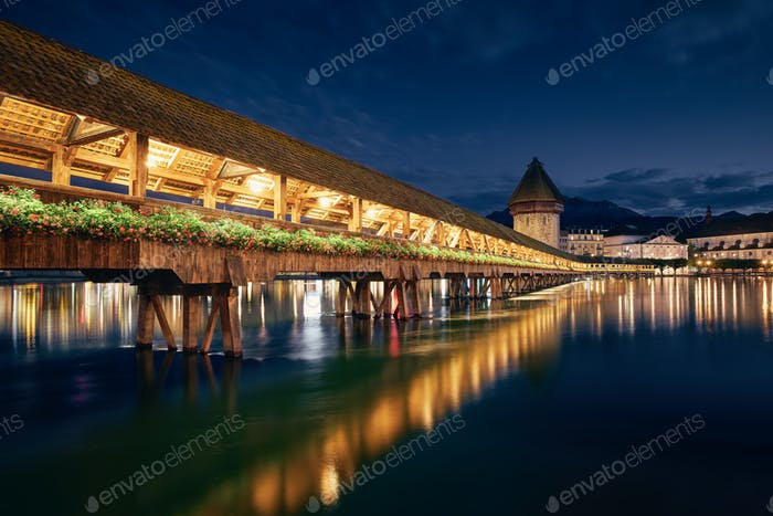 Illuminated historical Chapel Bridge at twilight