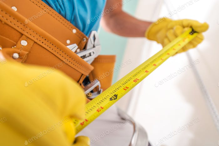 Measuring Tape in a Hand