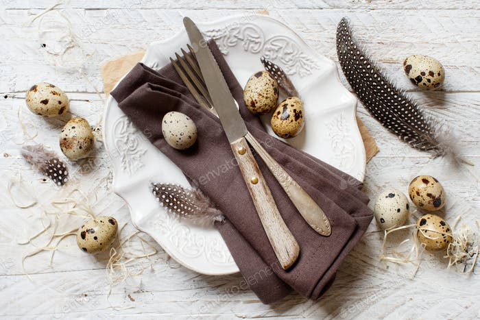 Easter table setting with quail eggs top view