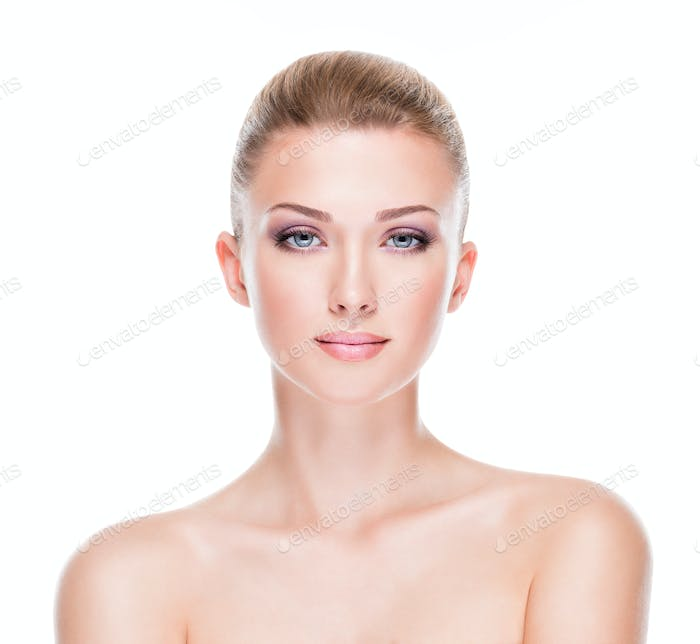 Portrait of young beautiful woman with a healthy clean skin