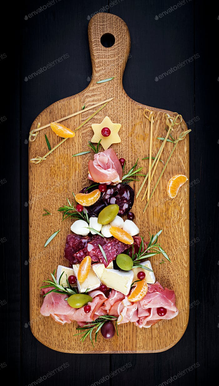 Antipasto platter with ham, prosciutto, salami, cheese,  crackers and olives