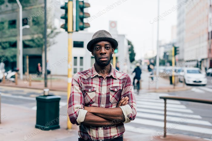 Half length of young handsome afro black man posing outdoor in t