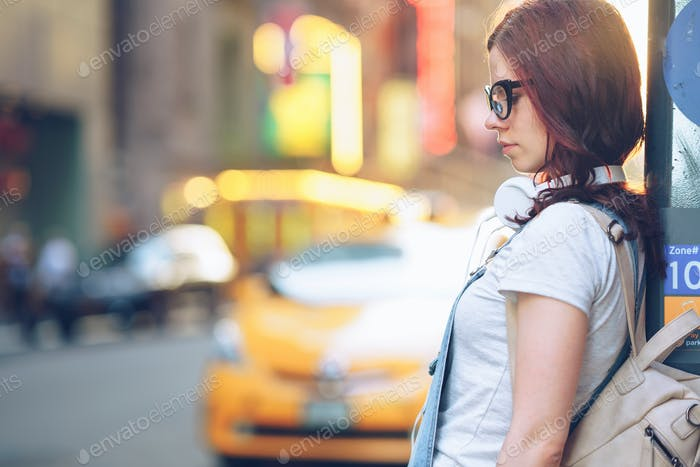 Attractive girl with headphones in the city