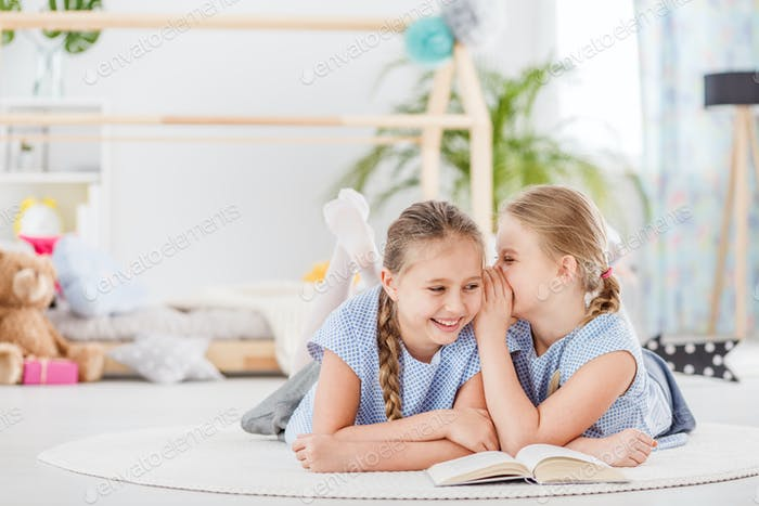 Two girls talking and laughing