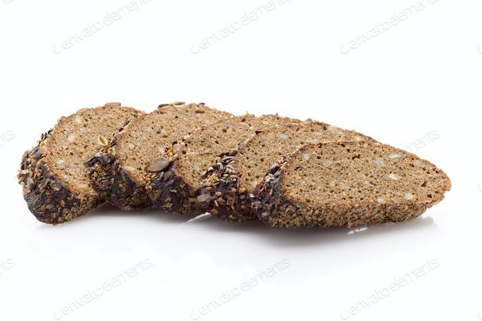 Rye bread slice on a white background.