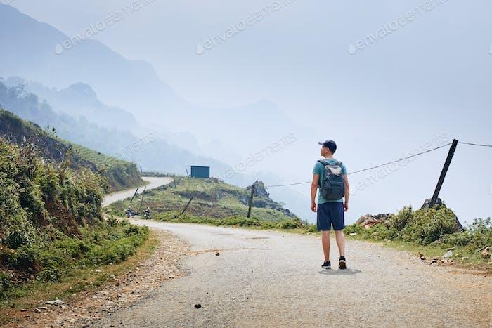 Man on winding road