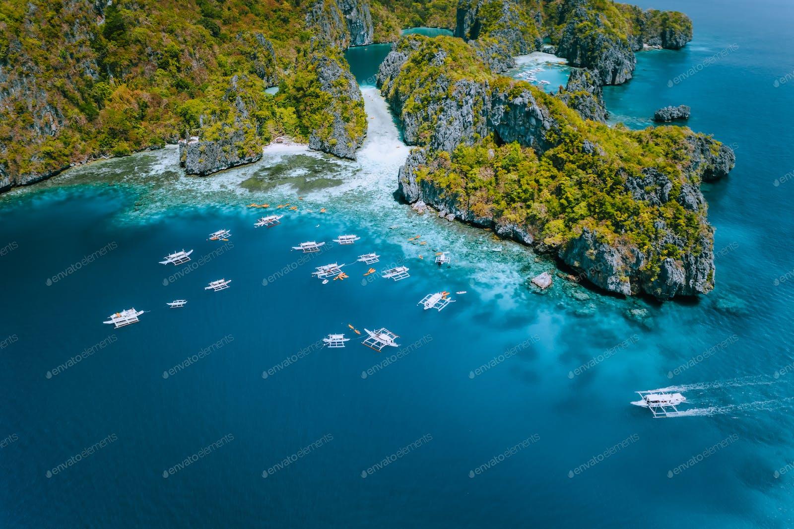 Aerial View Of Amazing Mililoc Island Tourist Boats Near Big Lagoon El Nido Palawan Philippines Photo By Shunga Shanga On Envato Elements