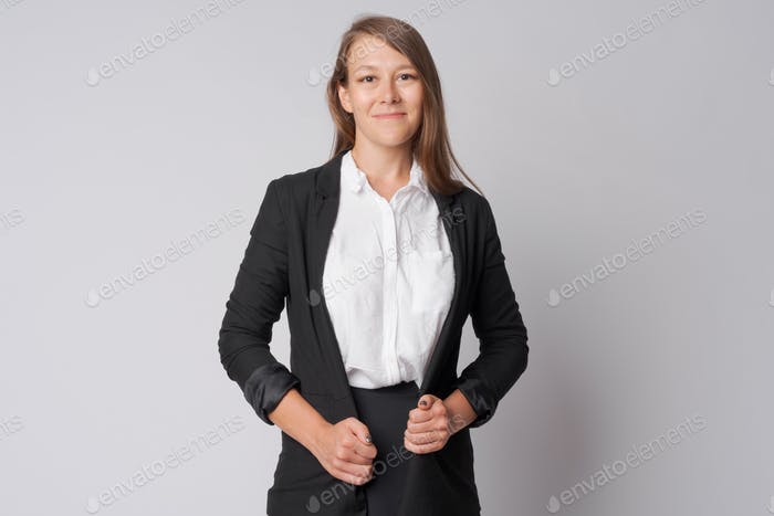 Portrait of happy young beautiful businesswoman smiling