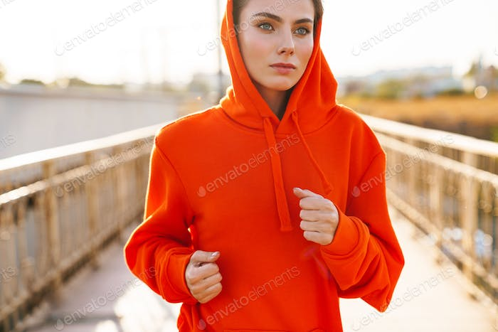 Fitness woman outdoors running.