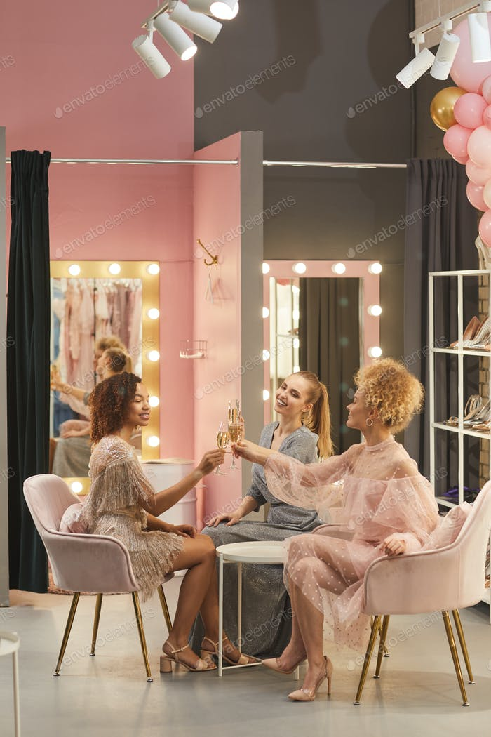 Beautiful Young Women Drinking Champagne in Dressing Room