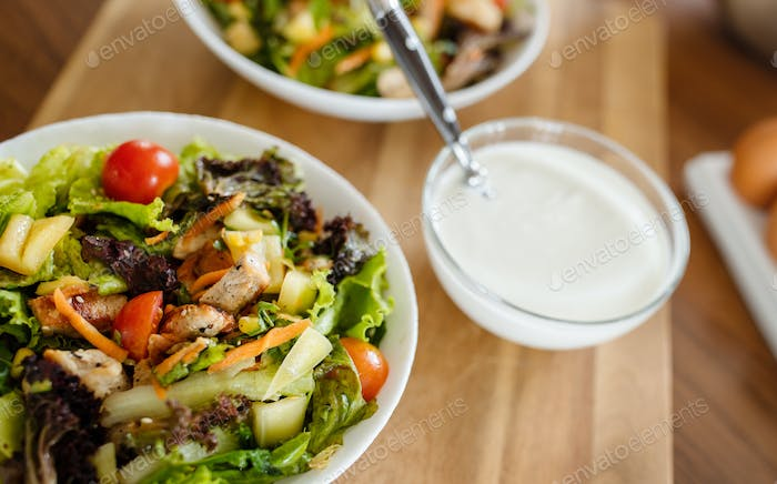 Chicken caesar salad with grilled chicken. Healthy food concept