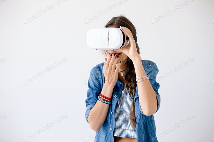 Girl portrait giggling while using VR Glasses