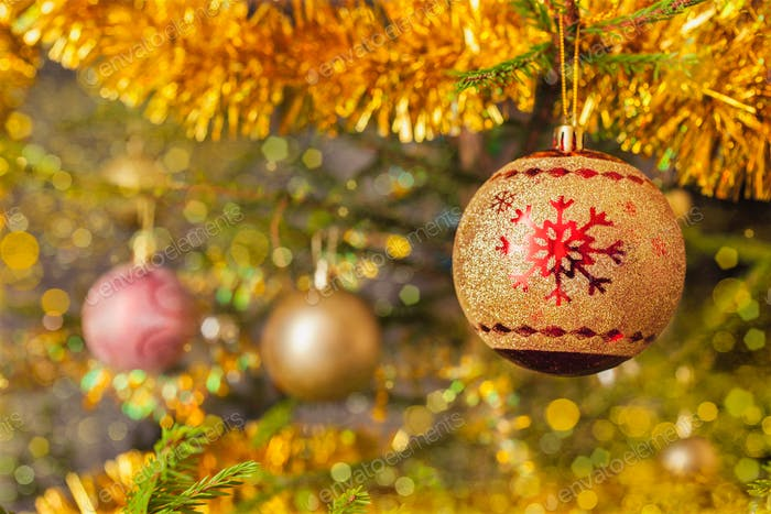 Decoration bauble on decorated Christmas tree background
