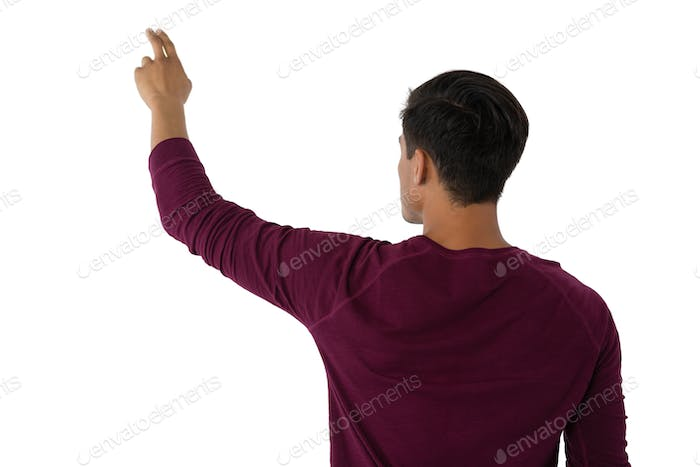 Businessman touching invisible imaginary screen