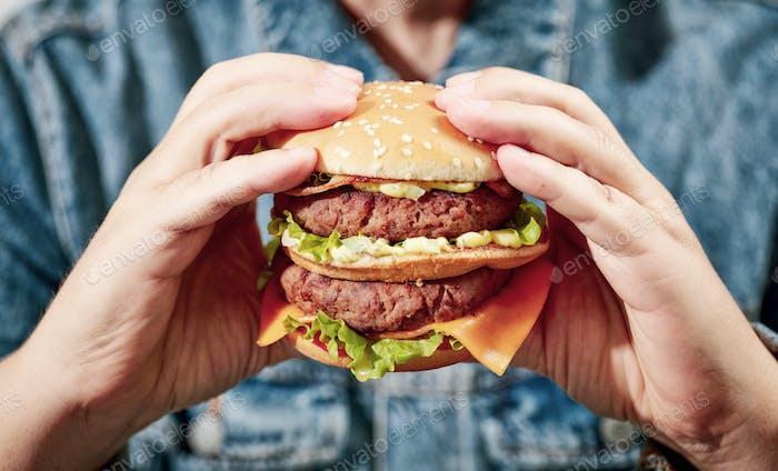 burger in human hands