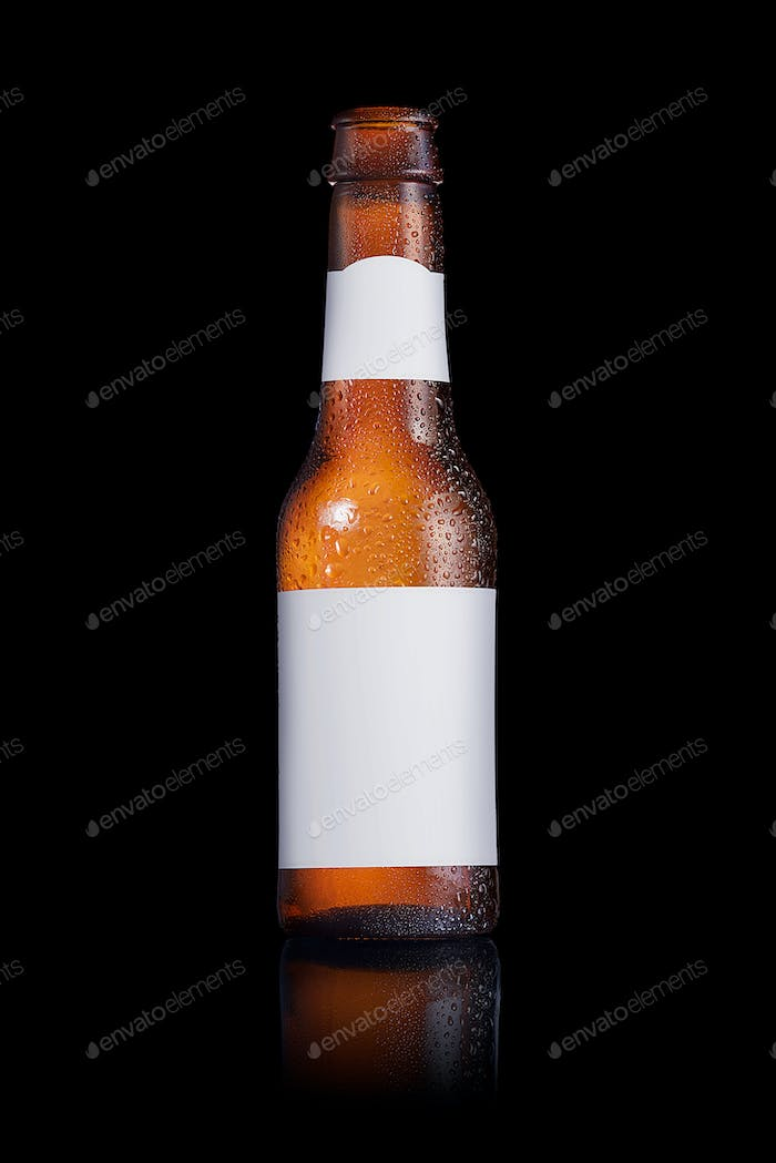 Beer bottle with a blank label on a black background
