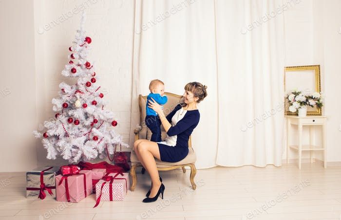 mother and baby little son playing home on Christmas holidays