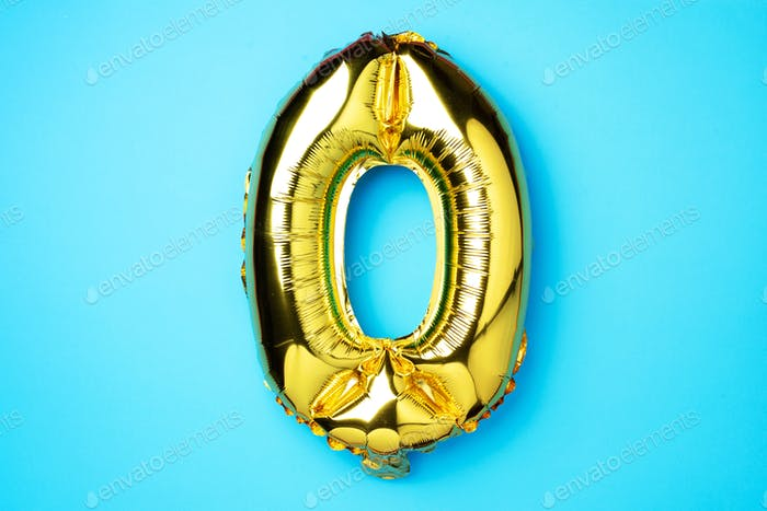 Creative layout. Golden foil balloon number and number zero 0.