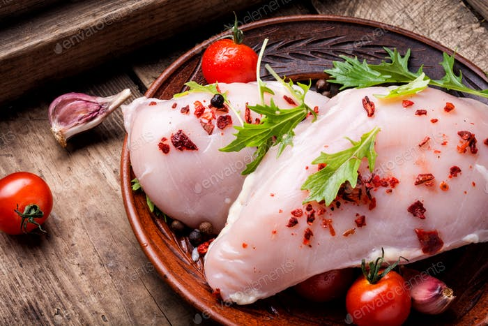 Fresh raw chicken on kitchen cutting board