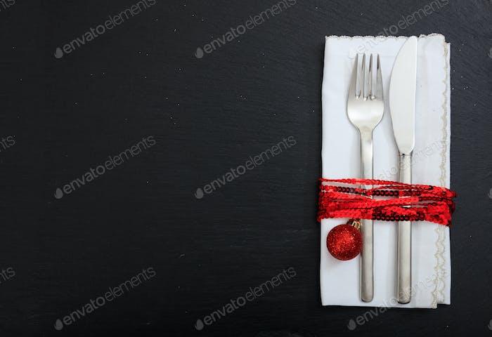 Christmas place setting on black background