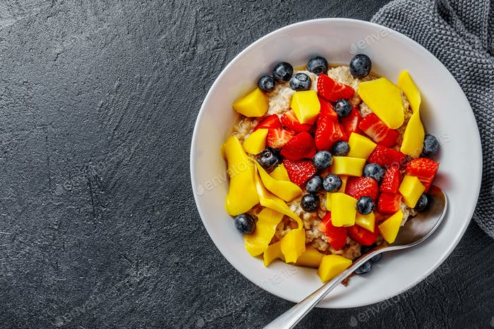 Homemade porridge served with fruits and berries