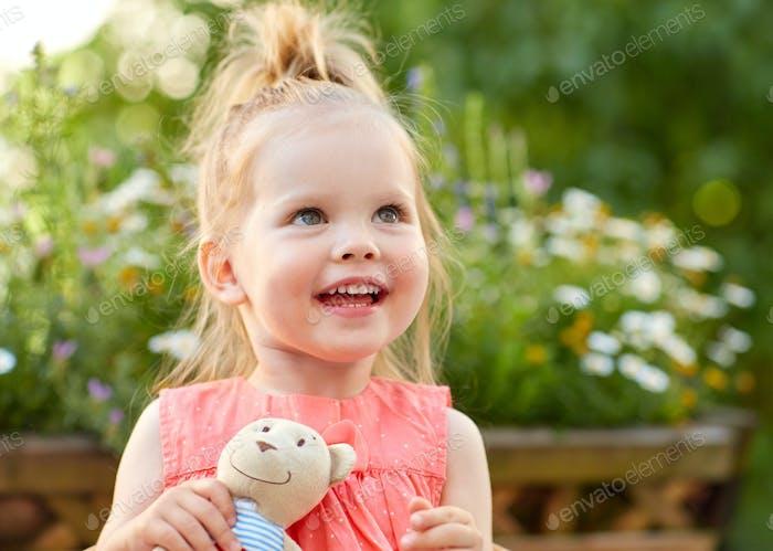 portrait of happy beautiful little girl outdoors