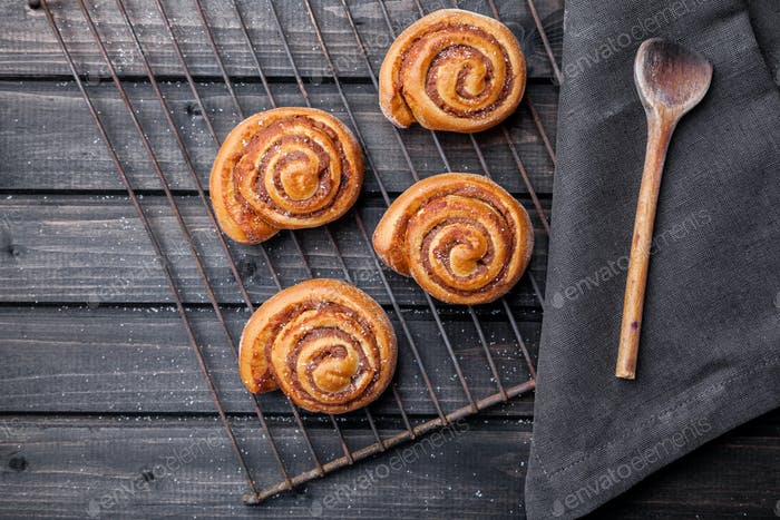Delicious pastry on dark wooden background