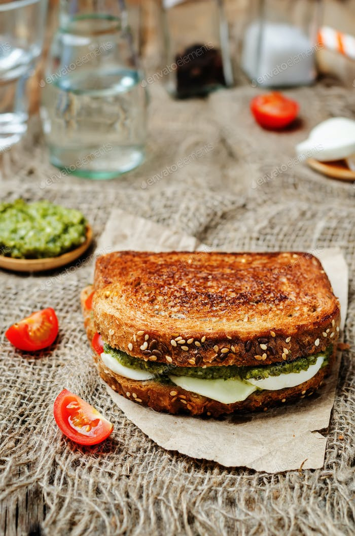 Pesto Mozzarella tomatoes grilled rye sandwich