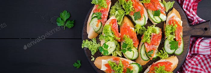 Tapas.  Salted Salmon, butter and cucumber toast sandwiches on w