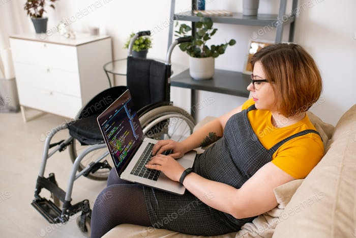 Disabled woman coding at home