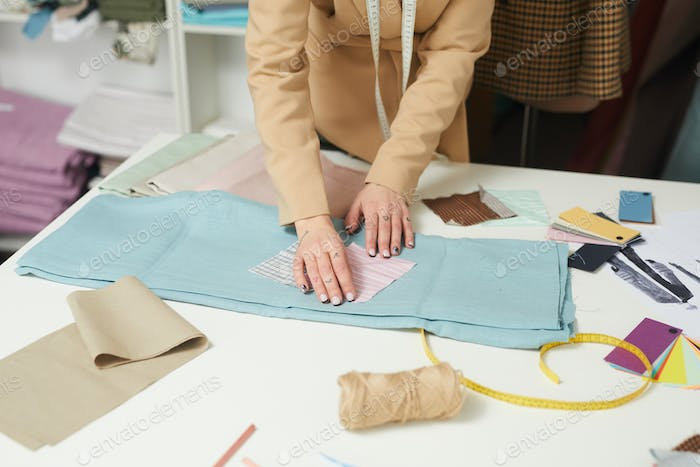Designer working with fabric
