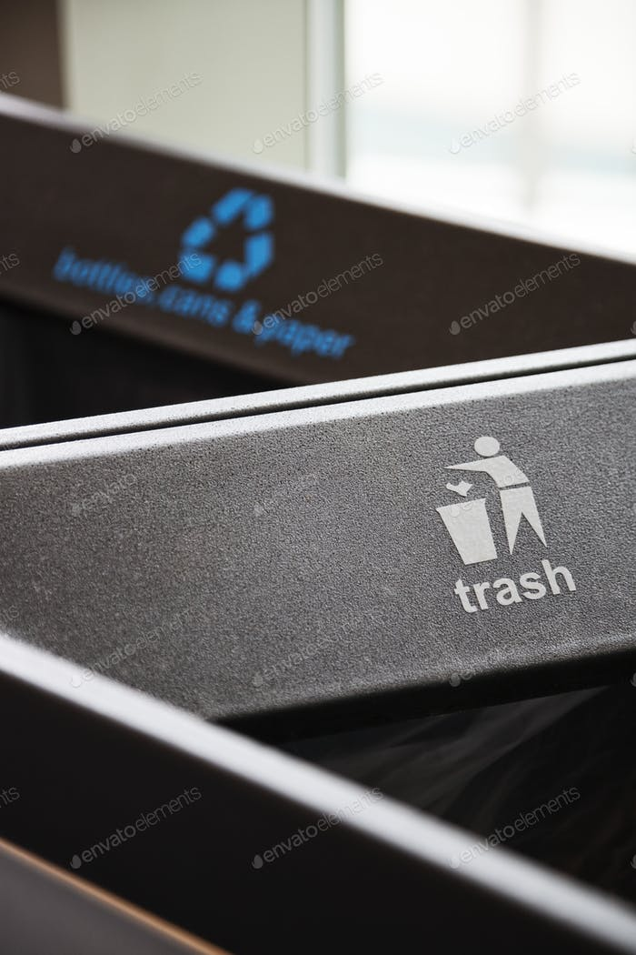 A closeup of recylcling bins for trash.