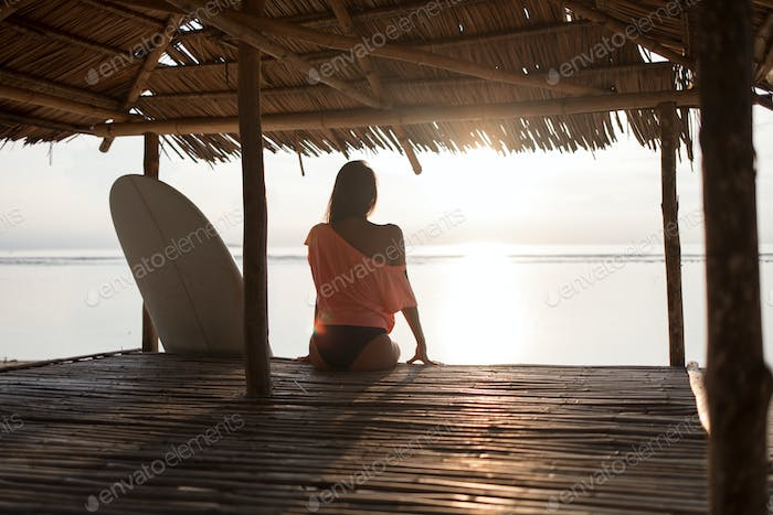 young surfer woman or girl silhouette