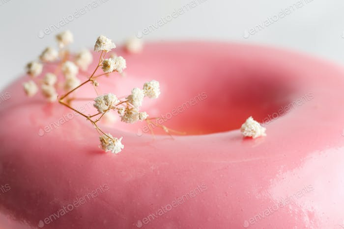 Close up view glazed surface of homemade souffle from strawberry fruits with plant twig for