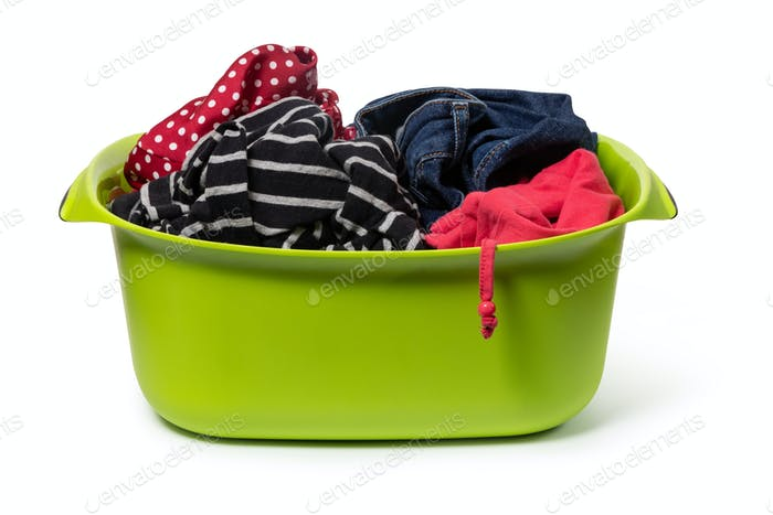green plastic wash bowl with clothing
