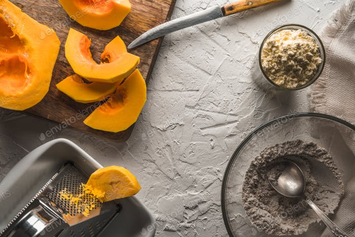 Pumpkin, flour on a white table for making pancakes