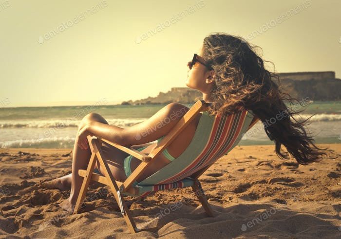 Girl on a deck chair