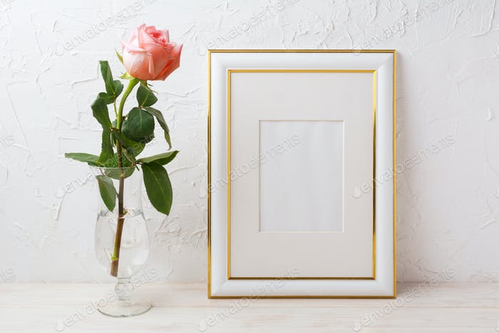 Gold decorated frame mockup with rose in exquisite glass vase