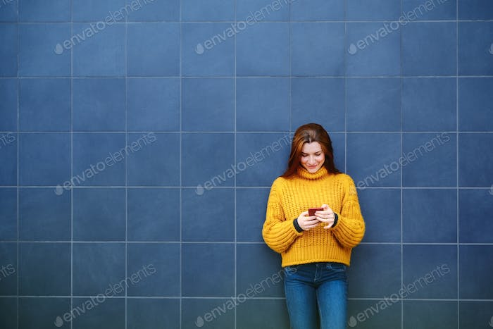 Young Redhead Woman Sending Text Message With Phone