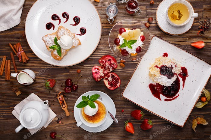 Desserts with berries and tea
