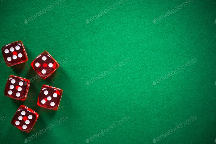 Red poker dices on green casino felt, spotlight background