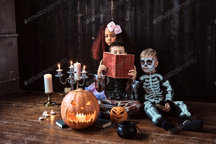 Thumbnail for Halloween party with group children who sitting together on a wooden floor in an old house