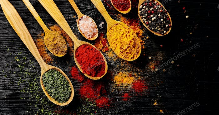 Different types of spices in spoons