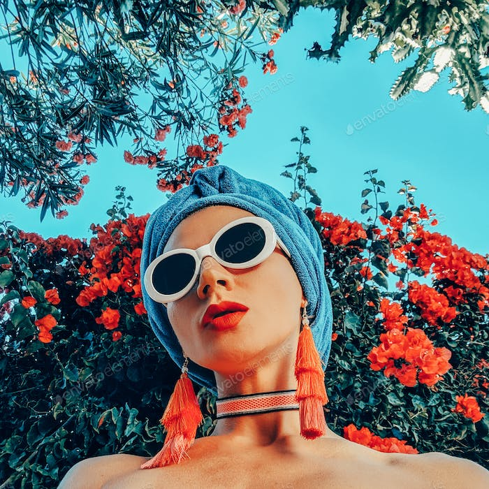 Model in fashion beach accessories. Head scarf, sunglasses and e