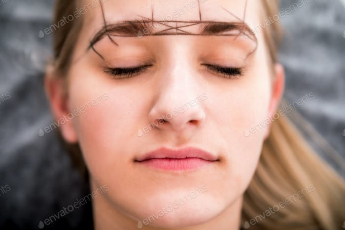 Preparing to permanent make up on eyebrows at beauty salon