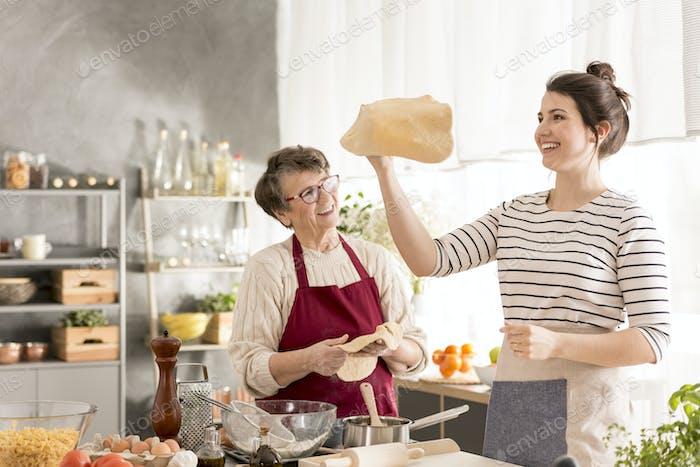 Woman shaping pizza dough