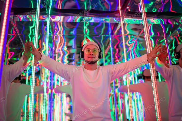 Professional dancer Dancing In a neon mirror labyrinth
