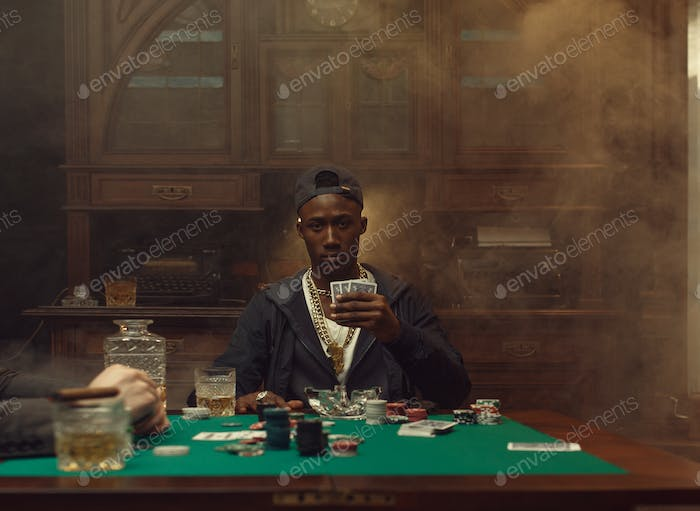 Poker player plays in casino