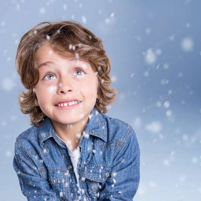 Child looking snow