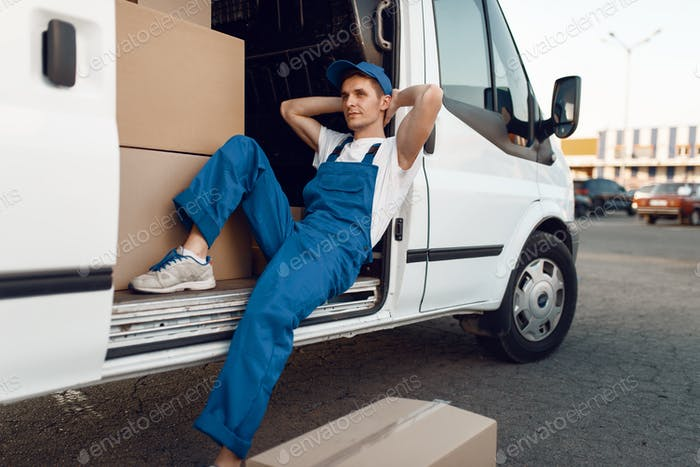 Deliveryman relaxing in the car during a break